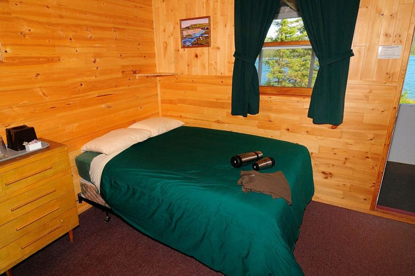 Plummer's Great Slave Lake Lodge Guest Cabin Bed